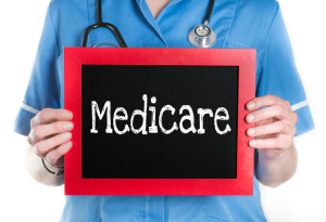 Don't get caught in the Medicare Death spiral _ doctor holding sign